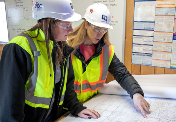 Image of two women looking at plans